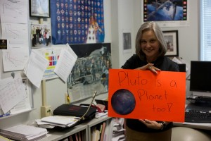 LAUREL, MD.- Mission Operations Manager Alice Bowman shows her support for the reclassified Pluto just meters away from the Control Room where she will be in charge of the team during closest approach. (Photo Credit: National Geographic Channels/Harriet Bailey)