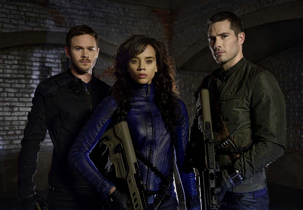 "KILLJOYS -- ""Bangarang"" Episode 101 -- Pictured: (l-r) Aaron Ashmore as John, Hannah John-Kamen as Dutch, Luke Macfarlane as D'Avin -- (Photo by: Steve Wilkie/Syfy)"